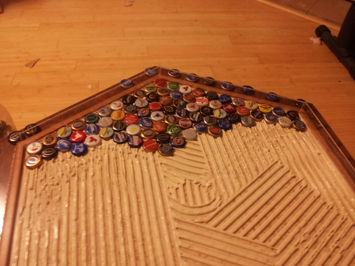 Started Laying The Caps In Tile Glue Of Beer Cap Table